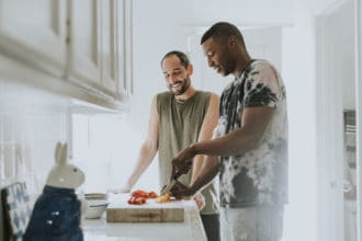 Gay couple cooking in the morning