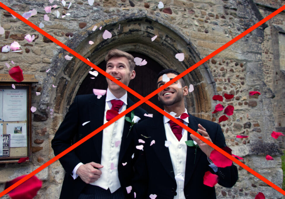 Gay weddings newly wed men, dressed in matching morning suits leave village church with smiles and are showered with coffetti.
